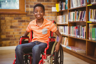 boy smiling in a library