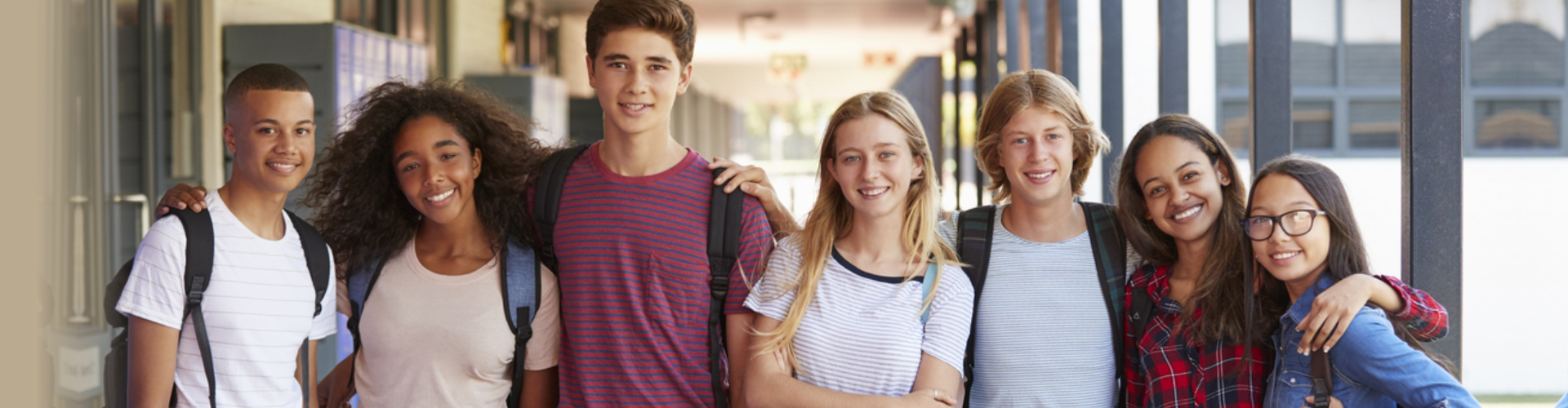 group of students standing and smiling